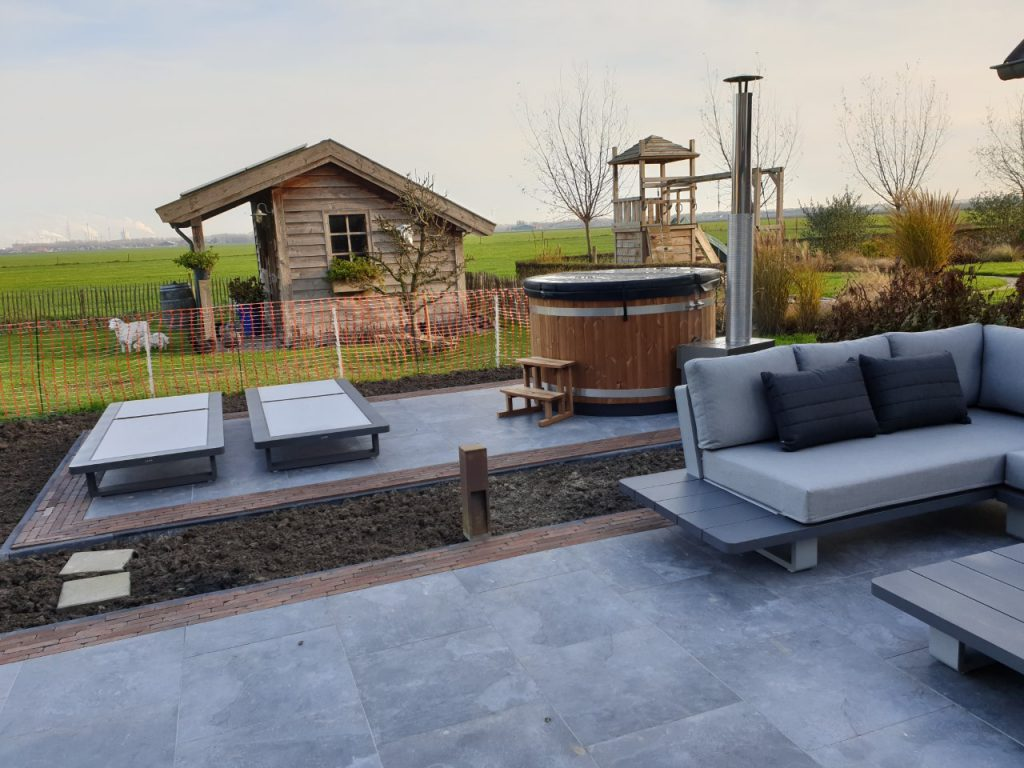 Zevenbergen achtertuin tuin terras trends sfeer geoceramica tuinhuis overkapping lounge